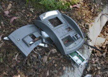 ATM broken on street curb